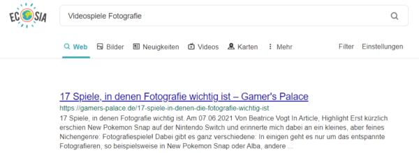 """Es wird die Suchmaschine Ecosia mit dem Suchbegriff """"Videospiele Fotografie"""" gezeigt. Der erste Treffer ist ein Artikel von gamers-palace.de."""