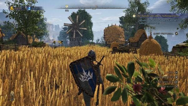 Der Screenshot zeigt die Erkundung der Welt in Third-Person-Ansicht. Zu sehen ist ein Weizenfeld, durch das die Hauptfigur gerade läuft.